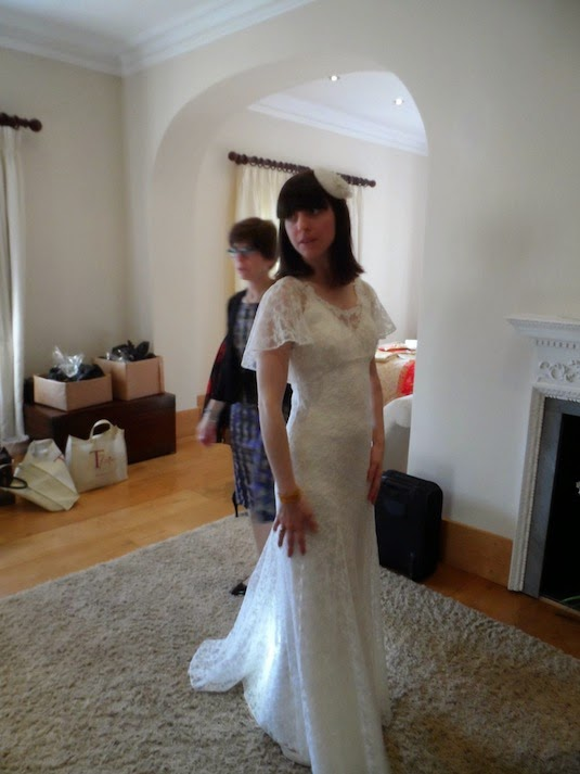 Vintage Bride Rachel getting ready for the ceremony in gorgeous 1903s wedding dress