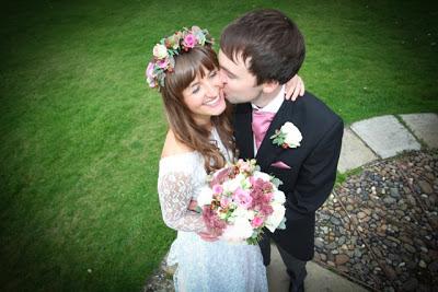 Real vintage bride Olivia on vintage wedding blog, kiss in the churchyard, c Heavenly Vintage Brides 2013