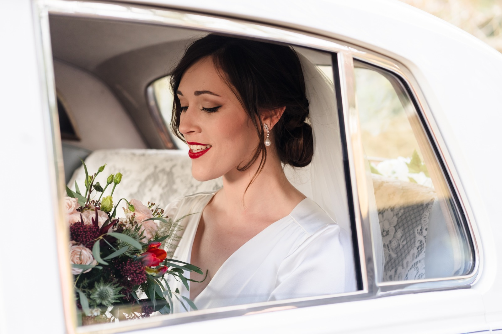 Sophie wearing 1940s style vintage wedding dress
