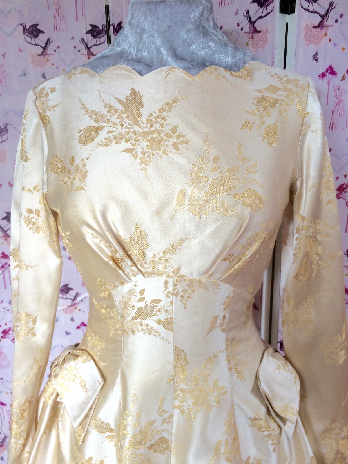 Lovely Pale gold satin 60s vintage wedding dress, gorgeous full skirt -just below knee length with long sleeves and scalloped boat neckline. Very cute and pretty.