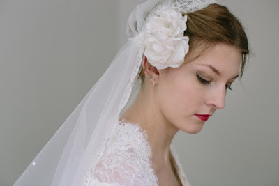 Vintage lace veil to complement a 1930s wedding dress. Side view.
