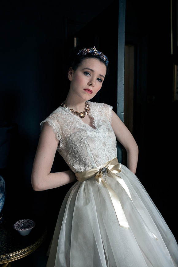 Close-up pic of model in vintage-style wedding dress Chantilly