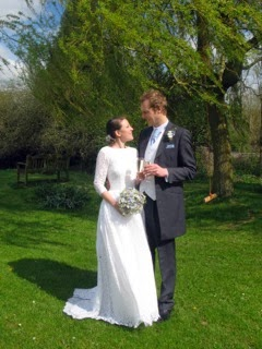1950s wedding dresses, c Heavenly Vintage blog, real bride Ali with husband, standing on lawn